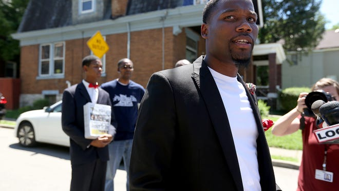 """Rev. Westley West, Pastor of Faith Empowered Ministries in Baltimore speaks with the media Thursday July 30, 2015,  at the intersection where Samuel DuBose was shot and killed July 19 in Mount Auburn. West drove 10 hours from Baltimore  to show support for Samuel DuBose who was shot and killed by a former University of Cincinnati police officer. """"This was a life that was taken, somebody is going without their father, without their child ... It's not just Baltimore, it's everywhere"""", West said."""