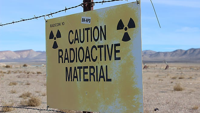 A sign cautions employees of potential radiation risks at the Nevada National Security Site, previously called the Nevada Test Site, now maintained by the U.S. Department of Energy.