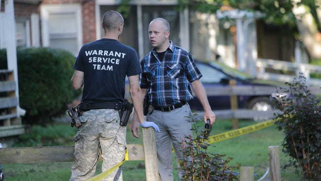 Lafayette police detectives investigate a shooting, Tuesday, Aug. 4, 2015, that was reported in the 2000-block of Perrine Street.