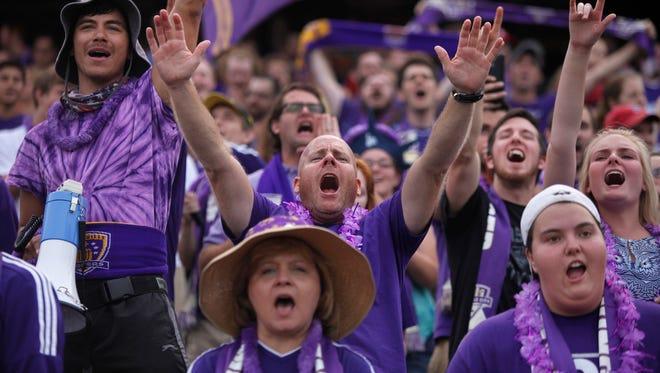 Matt True, center and fellow Louisville FC fans yelled their encouragement to the team. Aug. 5, 2015.