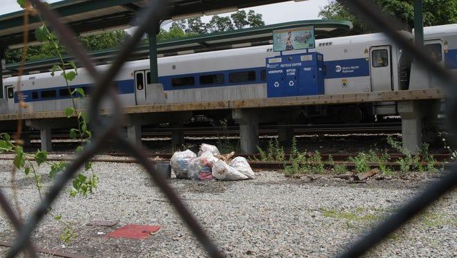 Garbage bags alongside the platform at the Peekskill train station.