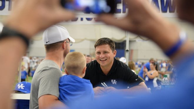 Offensive coordinator Shannon Dawson talks with fans during the University of Kentucky Football fan day at the Nutter Field House in Lexington, Ky., on Saturday August 8, 2015.