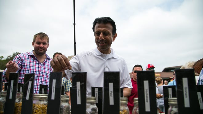Republican presidential hopeful Gov. Bobby Jindal casts his corn kernel vote during the Iowa State Fair on Saturday, August 22, 2015.
