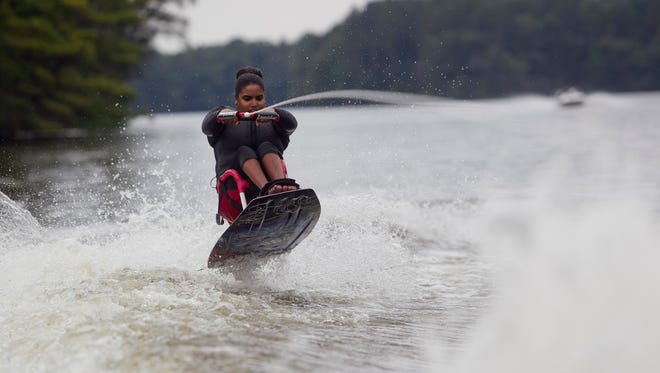 Sarah Holm of Baraboo sit-down water skis during the Big Pull event at Lake Wazeecha in Grand Rapids, Saturday, Aug. 29, 2015. Holm was part of the adaptive water ski during the event.