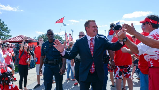 UL head football coach Mark Hudspeth is greeted by fans as he arrives at Cajun Field Saturday ahead of the Cajuns' first home game of the season against NSU.
