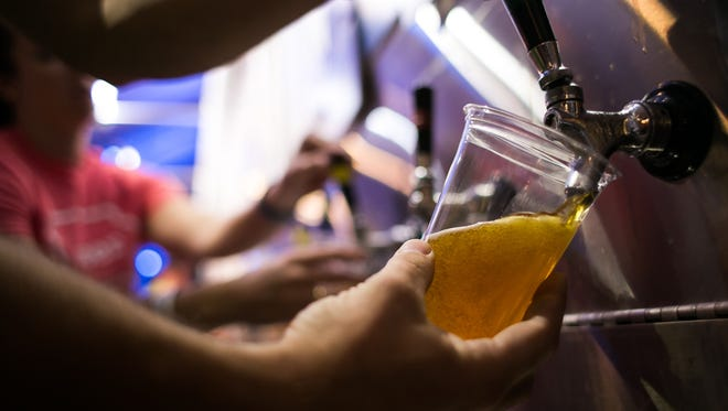 A beer is poured inside the Iowa Craft Beer tent during the Iowa State Fair on Friday, August 21, 2015.