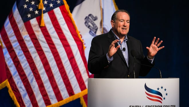 Republican presidential candidate Mike Huckabee speaks during the Faith and Freedom Coalition Dinner at the Iowa State Fairgrounds in Des Moines on Saturday, Sept. 19, 2015.
