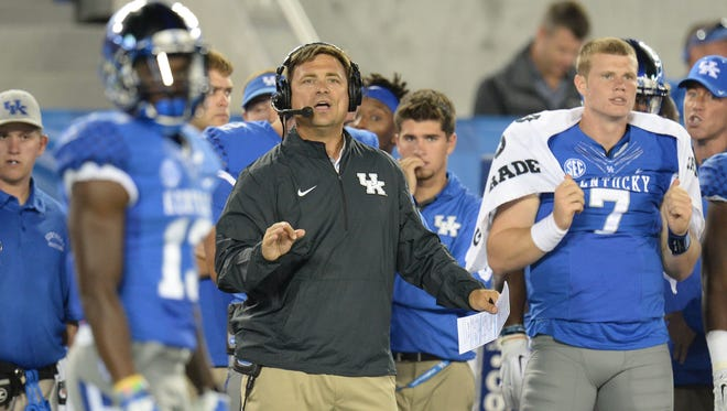 UK offensive coordinator Shannon Dawson during the first half of the University of Kentucky - Florida football game at Commonwealth Stadium in Lexington, Ky., on Saturday, September 19, 2015. 