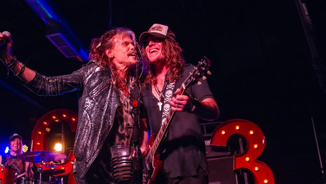Steven Tyler, left, joins The Cadillac Three on stage at the Cannery Ballroom in 2015.