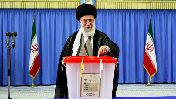 In this photo released by an official website of the Iranian supreme leader's office, Supreme Leader Ayatollah Ali Khamenei casts his ballot in the presidential election without publicly endorsing a candidate, in Tehran, Iran, Friday, June 14, 2013. The nuclear agreement negotiated between Iran and six world powers, including the United States, has become an issue in Arizona's 2016 U.S. Senate race.