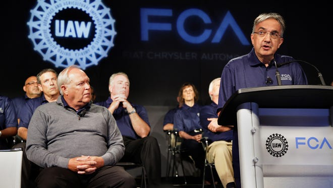 Fiat Chrysler CEO Sergio Marchionne speaks, while UAW President Dennis Williams looks on, during an event to mark the ceremonial beginning of its contract talks in Detroit on Tuesday, July 14, 2015.
