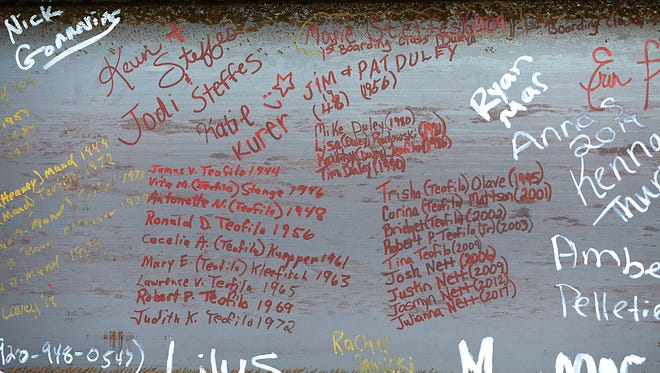 Hundreds of names decorate a steel beam used in the construction of an addition to St Mary's Springs Academy.