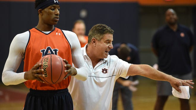 Auburn head coach Bruce Pearl directing freshman Horace Spencer during the team's first practice session of the 2015-16 season. Spencer has undergone knee surgery but isn't expected to miss any of the 2016-17 season.