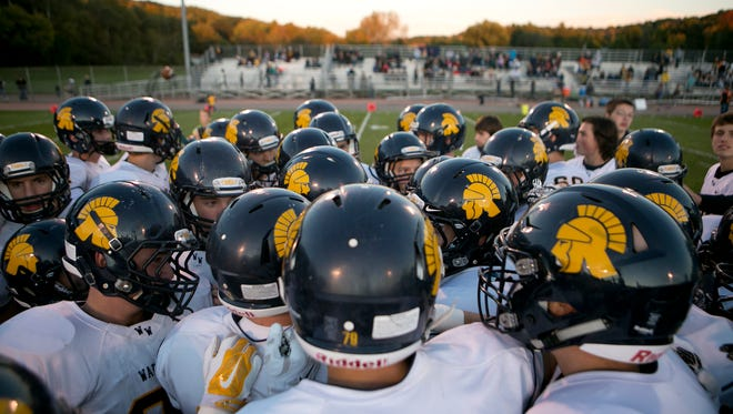 Wausau West huddles up before the Valley Football Association football game at Thom FIeld in Wausau, Friday, Oct. 2, 2015.