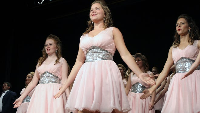 Chloe Metcalf (center) sings in a group choir and dance ensemble during a show choir performance at Elgin High School. Metcalf was voted Marion Star Female Teen of the Month for September.