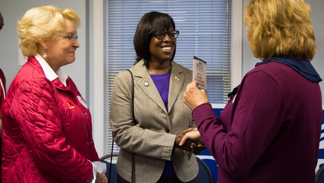 Jenean Hampton, candidate for lieutenant governor, center, talks faith and politics with Aprile Hunt, right, of Heartland Apostolic Prayer Network, and Jo McCormick before U.S. Sen. Rand Paul and Republican governor candidate Matt Bevin take the stage during a rally at Kentucky State University's Baptist Campus Ministry in Frankfort, Ky. October 3, 2015.