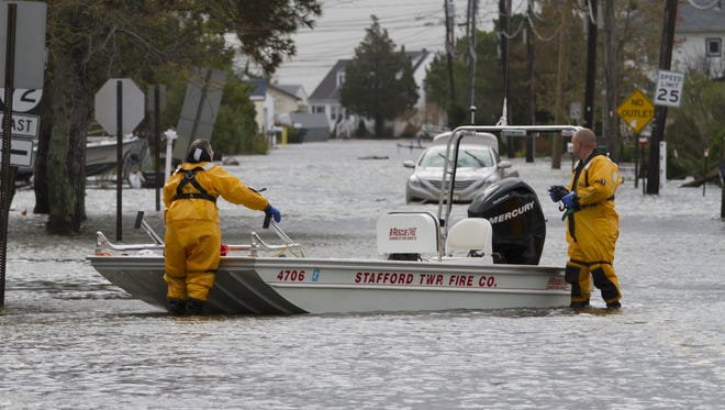 Stafford firefighters try to locate residents living in the Beach Haven West section to evacuate them during superstorm Sandy.