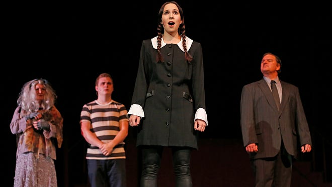 "Amber Boardman, who plays Wednesday Addams, sings during the dress rehearsal of ""The Addams Family Musical."""