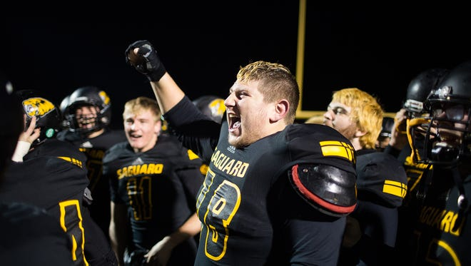 Saguaro offensive lineman Michael Weinstein celebrates after winning a Division III semifinal game against Queen Creek on Nov. 21, 2014.