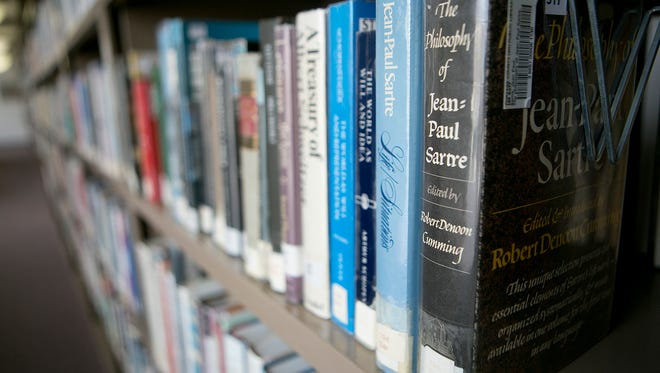 Books line the shelves of the non-fiction section at the Portage County Public Library's main branch in Stevens Point on Monday, Oct. 19, 2015.