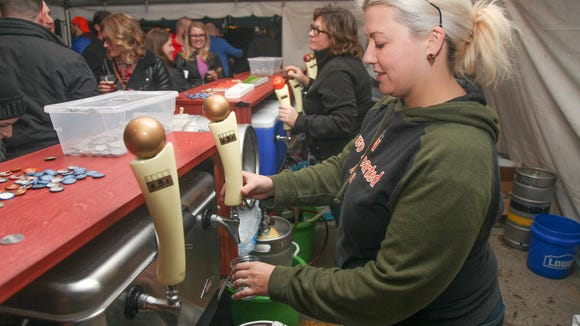 Bridget Gauntner of Grand Rapids pours a glass of Uberon, a whiskey-barrel-aged version of the iconic Oberon Ale.