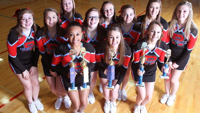 Members of the Ridgedale Rockets varsity cheerleading squad display their summer trophies after practice on Monday. The squad of Taylor Boyd, Laney Davis, Kamryn Dyer, T'erria Jones, Katie Kagel, Kenzie Smith, Sierrah Williams, Mya Craig, Hannah Edler, Anna Hundley and Allie Seckel were invited to perform at the Citrus Bowl in Orlando on New Year's Day after taking top honors at the Universal Cheer America competition held at Bowling Green University this summer.