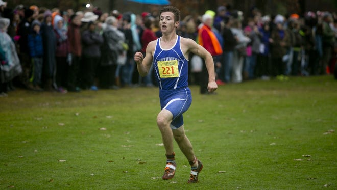 Green Bay Southwest's Alec Basten runs toward the finish line during the Division 1 boys race at the 2015 State Cross Country Championships at the Ridges Country Club in Wisconsin Rapids, Saturday.