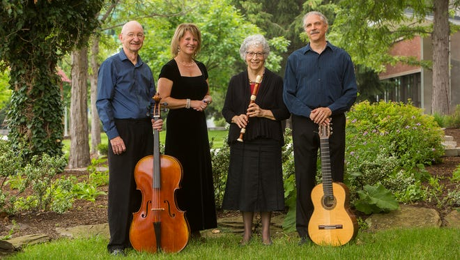 Early On, from left: Steve Stalker, cello; Christina Salasny, vocalist; Barbara Kaufman, recorder; and Paul Sweeny, guitar, posed outside the Fine Arts Building.