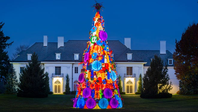 Karl Unnasch's 40-foot Christmas tree installation is made of children's plastic toys.