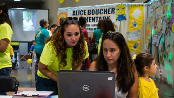Gabriela Rio-Hernandez, teacher at Alice Boucher elementary with parent Carmen Rubio at the Fall Frenzy at the Cajundome. Nov 7, 2015.