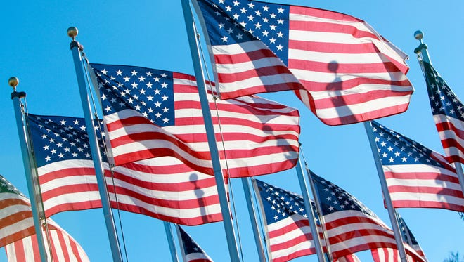 American flags waved in the breeze in front of the Tillman H. Harpole American Legion Post 249, the day after Veterans Day in 2013.