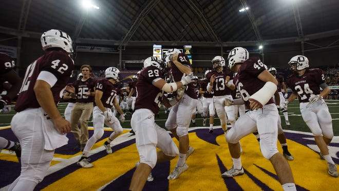 Dowling Catholic rushes to midfield before their semifinal game against Valley at the UNI dome on Friday, November 13, 2015 in Cedar Falls.