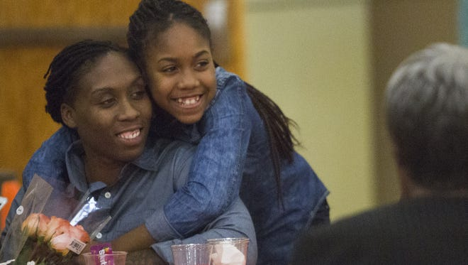 Rising STARS award recipient April Collier, left, with her 12-year-old daughter, Sanai. Crispus Attucks Association hosts its 32nd Annual Cultural Thanksgiving Celebration and Rising STARS Awards honoring community members who have positively impacted youth in York, Monday, November 16, 2015.