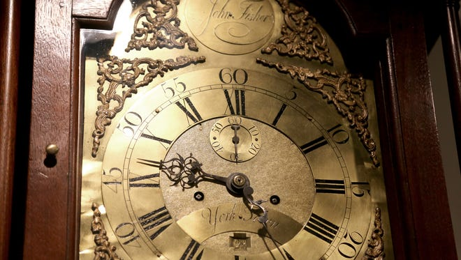 "The cast-brass tall case clock by John Fisher is one of Dan Roe's favorites. It is on display at ""A Timeless Collection; The John J. Snyder Jr. Exhibition"" at the York County History Center, Thursday, July 25, 2014."