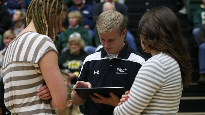 CSU volleyball technical coordinator Jared Hazel, middle, plays a key role in providing information to coaches and players.