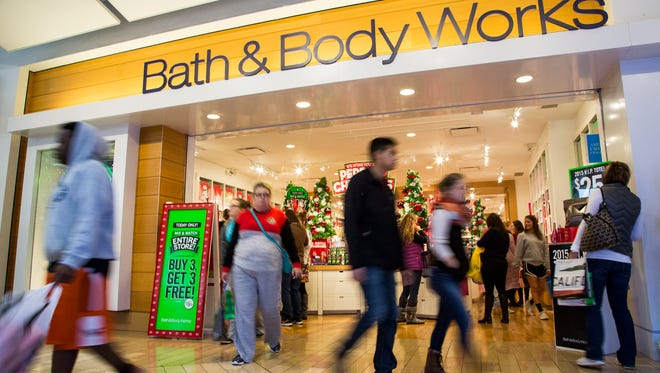 Shoppers pass by Bath & Body Works on Black Friday, Nov. 27, 2015, at Mall St. Mathews in Louisville, Ky.