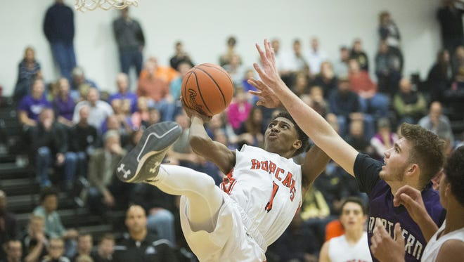 Northeastern's Brandon Coleman, left, is fouled by Northern York's Jack Walsh. Northeastern defeats Northern York, 86-43, in the Bobcat Tip-Off Classic at Northeastern High School on Dec. 4 in the 2015-16 season opener.
