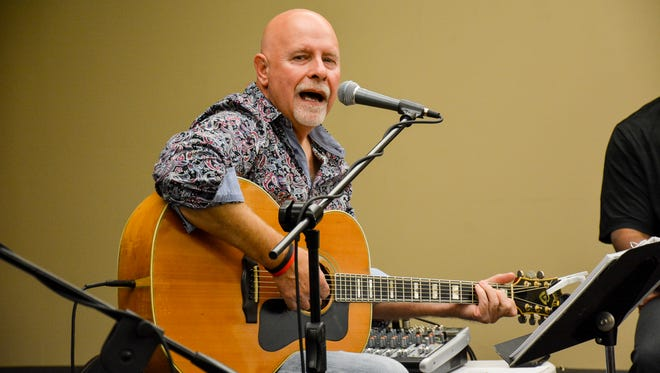 Singer Greg Martinez performs at Acadiana Roots Thursday at the Daily Advertiser.