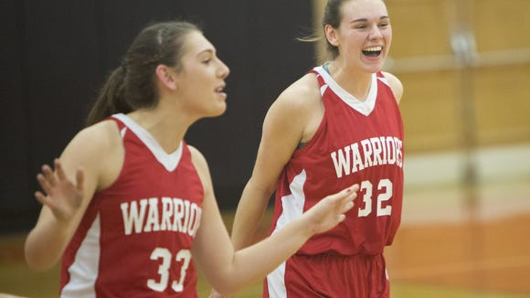 Susquehannock teammates Madison Stone, left, and Ashley Stone celebrate after the win. Susquehannock defeats York Suburban 43-31 in a girls' basketball game at York Suburban High School in Spring Garden Township, Tuesday, December 15, 2015.
