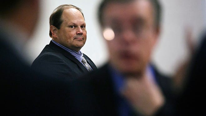 In this July 15, 2015 file photo, Eddie Tipton looks over at his lawyers before the start of his trial in Des Moines. The former security director of the Multi-State Lottery Association, accused of tampering with lottery drawings to rig jackpots in four states, was convicted of fraud in the attempt to claim a $16.5 million jackpot in Iowa. Investigators are now looking at payouts in 37 other states and U.S. territories that used random-number generators from the Iowa-based association, which administers games and distributes prizes for the lottery consortium.