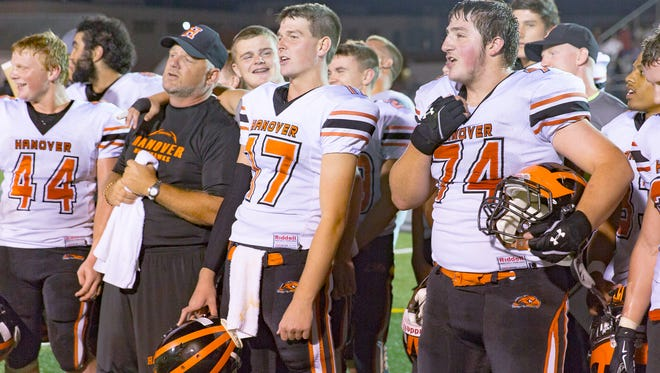 Just before exiting the field after a 2015 game at Bermudian Springs High School, the Hanover Nighthawks gathered to sing their alma mater alongside their coach, Bill Reichart, also a graduate of Hanover.