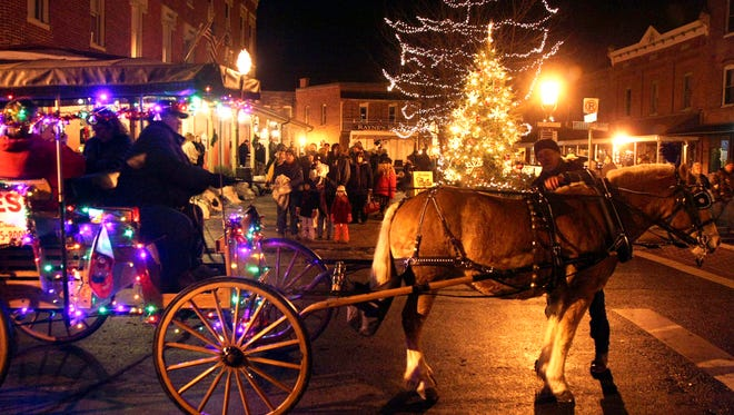 Carriage rides are offered during the New Year's Eve Celebration in downtown Berlin.
