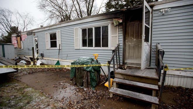 A trailer is burned out from an early morning fire at Plover Pine Village on Forest Drive, Tuesday, Dec. 22, 2015.