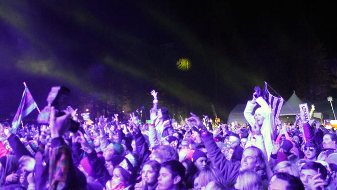 Music fans at the SnowGlobe Music Festival during New Year's Eve in South Lake Tahoe, California.