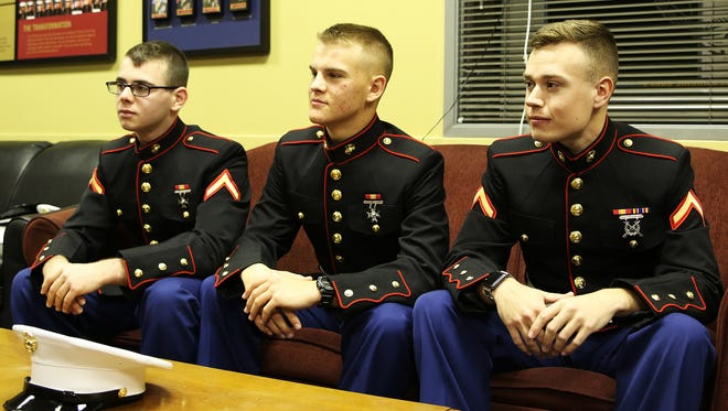 One of the three Marines who helped stop suspected thieves at a Michigan mall Dec. 22, 2015, said Marines always try to do the right thing. From left, Pfc. Blayne Edwards, Pvt. Alex Berezansky and Pfc. Ryan Delaca.