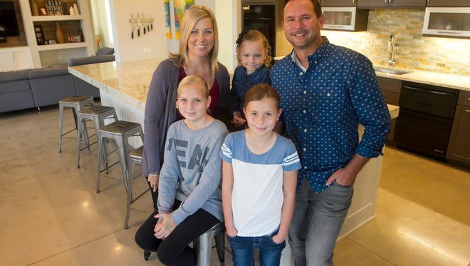 Karen Culbertson with her family - daughters Emery, 4, center, Kennedy, 12, left, and Presley, 9, right, and husband Brian.