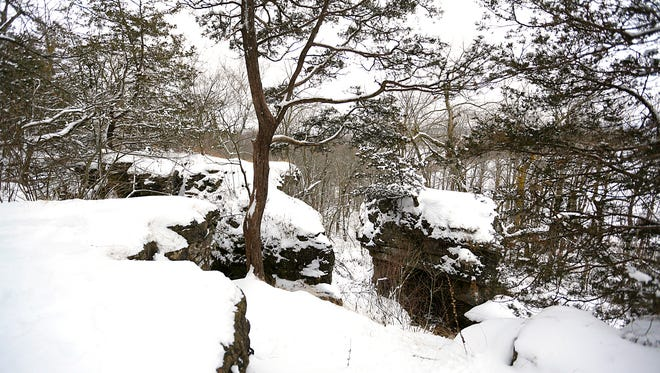 A snow covered ledge in the Oakfield Ledge Wildlife Area