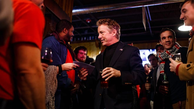 Republican presidential candidate Rand Paul accepts a birthday card from a supporter during a campaign stop at Buzzard Billy's in Des Moines on Thursday, Jan. 07, 2016.