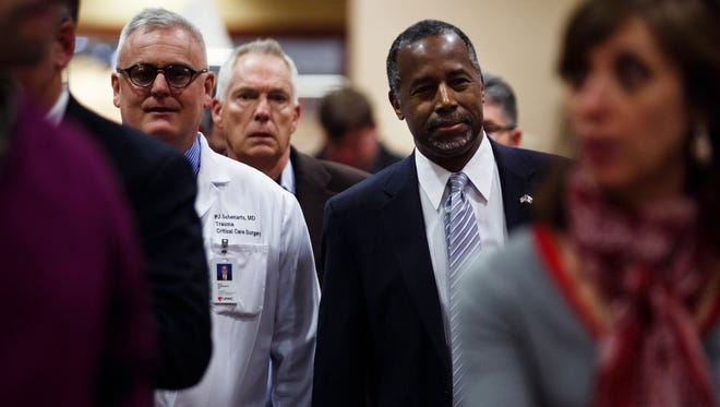 Republican presidential candidate Ben Carson walks arrives to address the media at the University of Nebraska Medical Center following the death of campaign volunteer Braden Joplin, 25, on Tuesday, Jan. 19, 2016, in Omaha. Joplin died in a car accident earlier Tuesday in western Iowa.