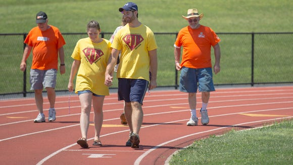 Walkers do a lap at an area Relay For Life.